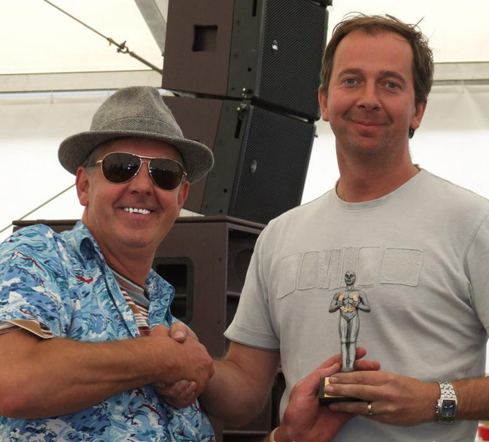 RUSS FELLOWS COLLECTS HIS VW ACTION HALL OF FAME 'OSCAR'