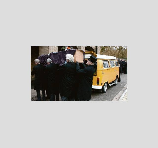 Farewell: Mourners carry the coffin at the funeral of Tony Minns.